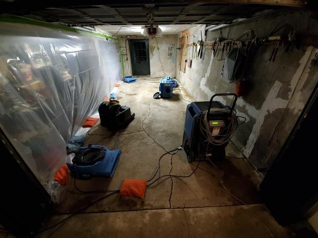 Equipment set up in the basement. Containment was placed to protect contents.