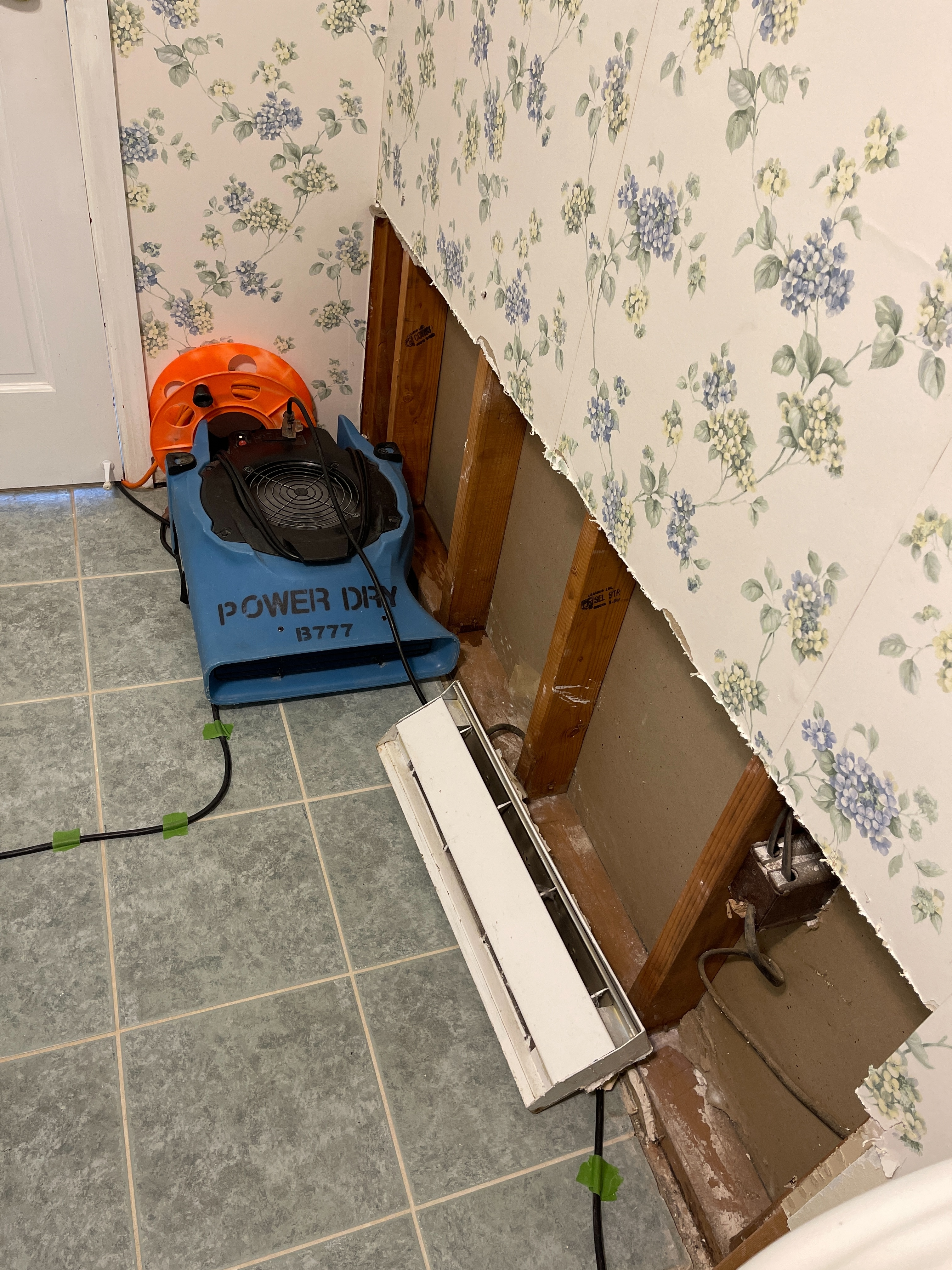 Drying of the affected drywall in the laundry room