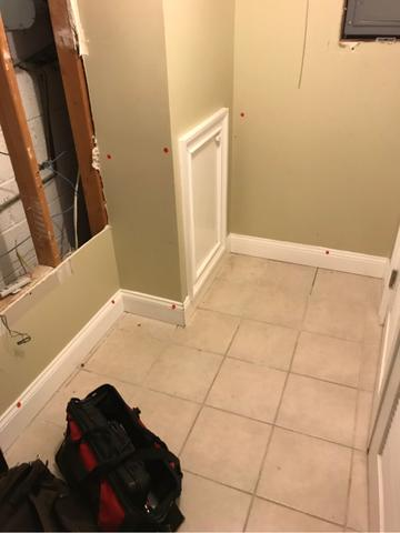 The drywall, trim, and tile materials were damaged from the sump pump failure
