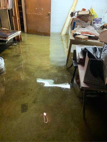 Sump pump failure caused 2 feet of standing water in the basement