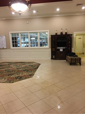 The leak originated from the overhead sprinkler system in the lobby